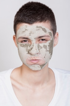 Model with face mask looking at camera