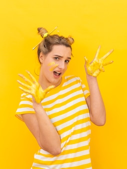 Model with painted hands posing