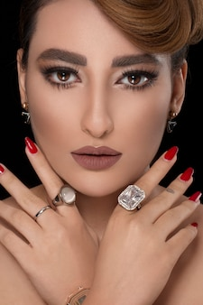 Model with party hairstyle and bronze makeup with diamond jewelry