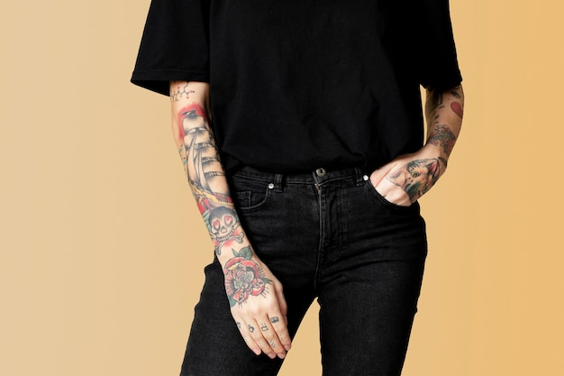 Model with tattoo in black t shirt and jeans