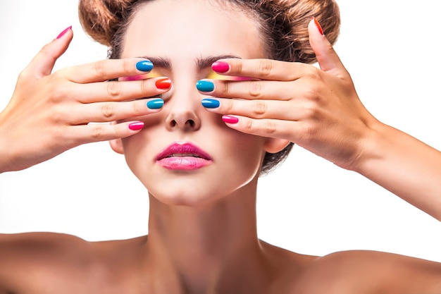 Model, a woman with bright makeup and bright nail polish on a white surface. studio, beauty, luster, varnish.