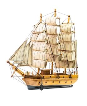 Model of the wooden antique schooner on white