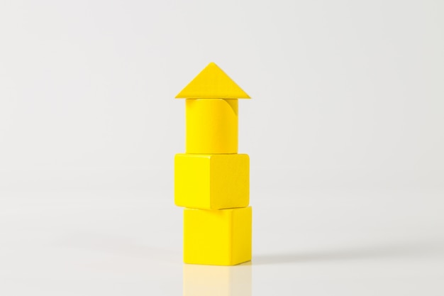 Model of the wooden building with yellow blocks