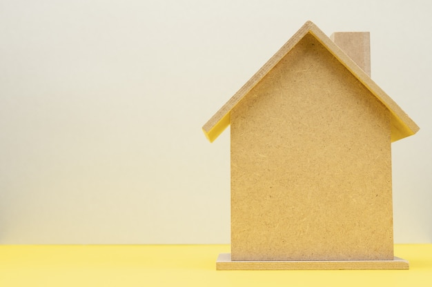 Model of a wooden house, concept of real estate purchase, mortgage