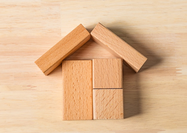 Model of the wooden house (real estate) on white background