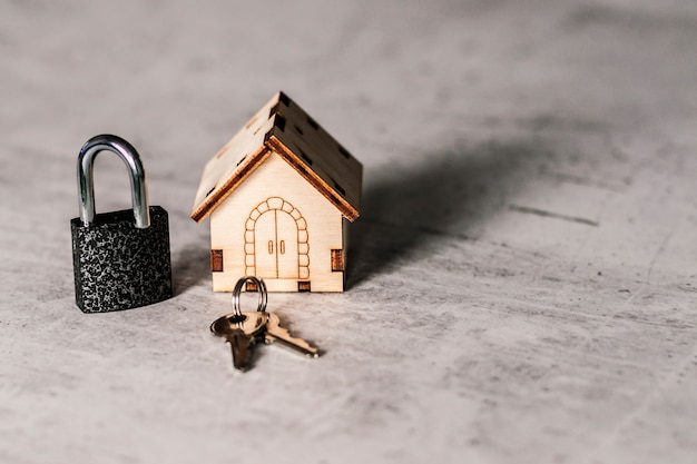 Model of a wooden house with a lock and keys