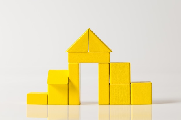 Model of the wooden house with yellow blocks