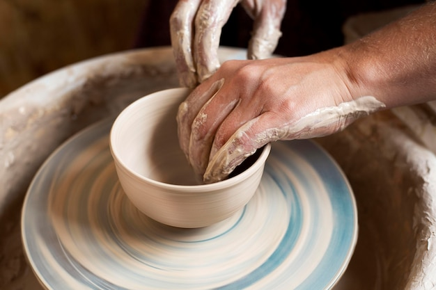 Modeling in clay on a potter's wheel