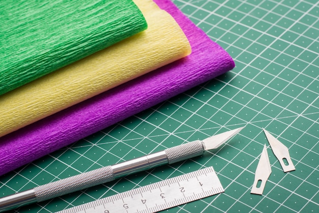 Modeling. stationery equipment and grunge paper on a green cutting mat