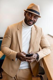 Modern african american man in beige suit