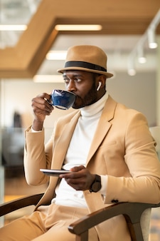 Modern african american man working in a caffe