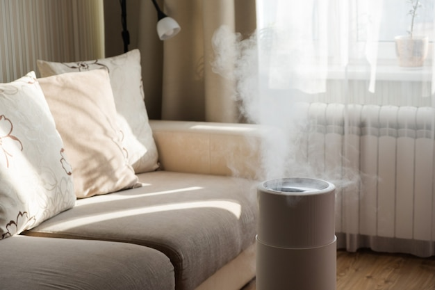 Modern air humidifier, aroma oil diffuser at home. improving the comfort of living in a house