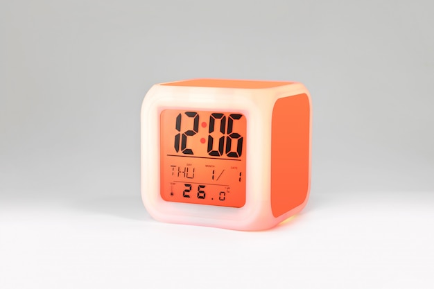 Modern alarm clock on white backdrops and copyspace.
