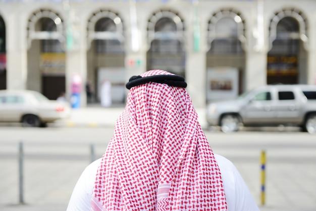 Modern arabic businessman on street walking