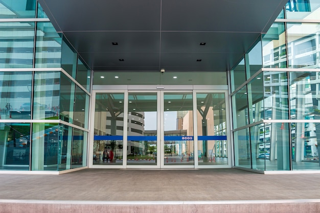 Modern architecture, blue-green glass, steel structure showing modernity, strength and professionalism