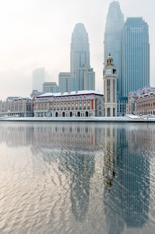The modern architecture of the haihe river in tianjin, snow scene, china