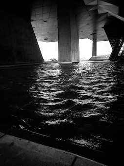 Modern architecture with columns and water