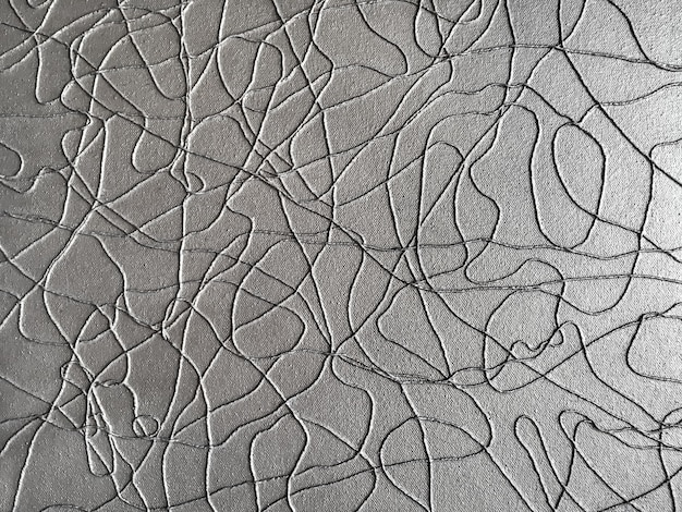 Modern art background from silver rope on gray paper