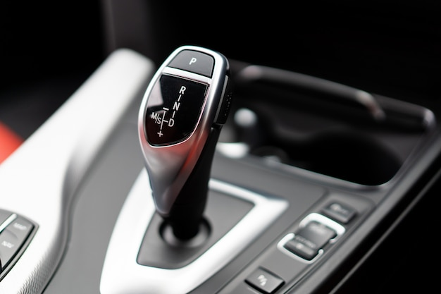Modern automatic gearstick (gear lever) in the modern car close up.