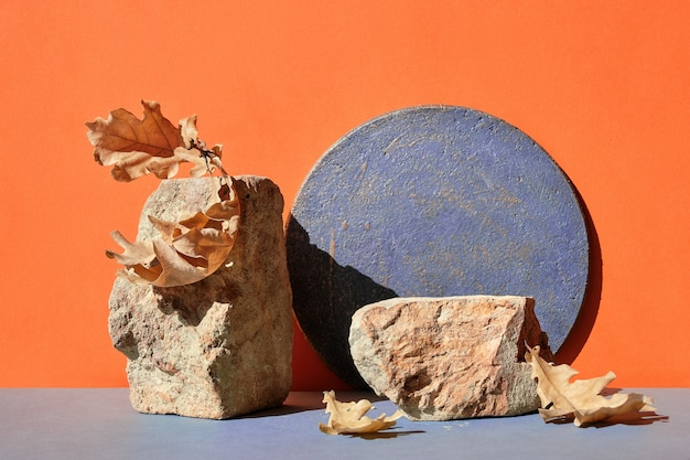 Modern autumn brick podium in orange and grey with natural decorations