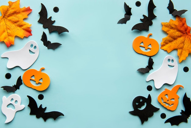 Modern background with bats  pumpkins leaves on a blue background