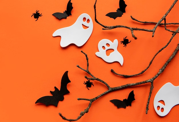 Modern background with bats  pumpkins leaves spiders on a orange background