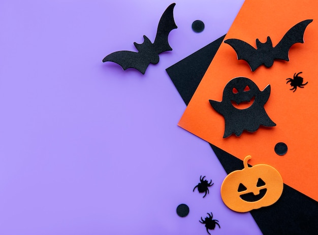 Modern background with bats  pumpkins leaves spiders on a violet background