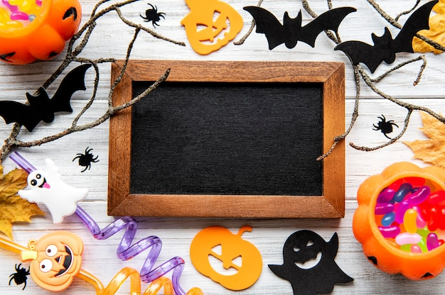 Modern background with bats  pumpkins leaves spiders on a wooden background