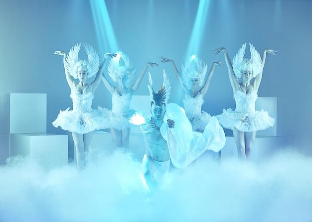 Modern ballet dancers on blue