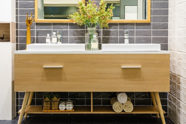Modern bathroom interior in foreground of counter top washbasin using natural materials.