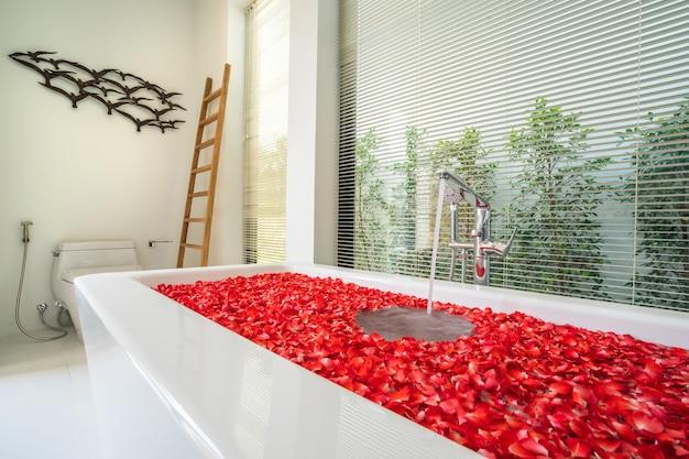 Modern bathroom, sinkm shower, and bathtub in luxury villa