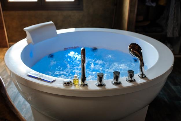 Modern beautiful hydro massage bath with water
