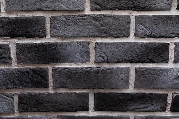 モダンな黒レンガの壁のテクスチャ背景