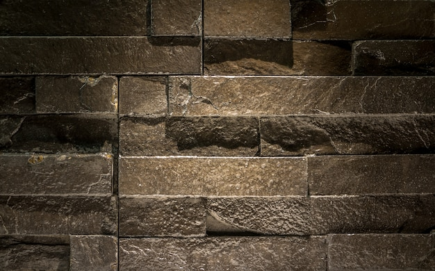 Modern brick wall - pattern of black slate wall texture and background