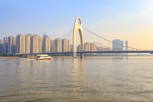 Modern bridge in zhujiang river and modern building of financial district in guangzhou city