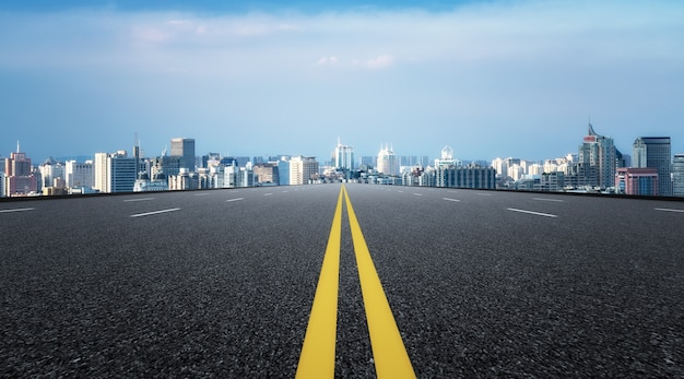 Modern building background and asphalt road in shanghai, china