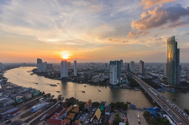 Modern building at riverside in twilight scene at bangkok