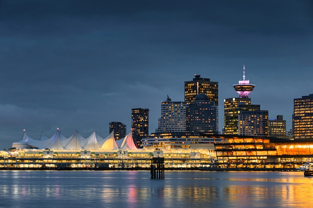 Modern buildings illumination with central market on coastline at stanley park, vancouver