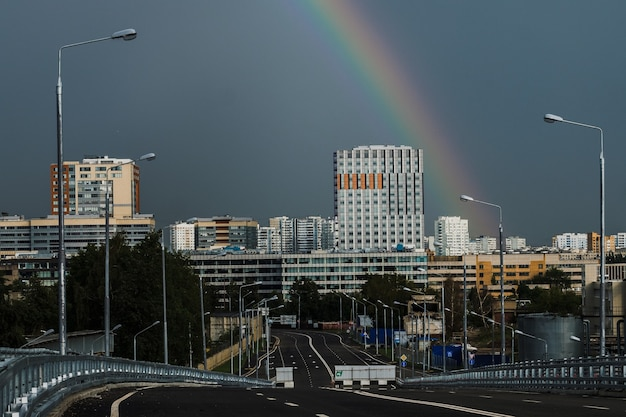 Modern buildings of moscow under the rainbow.