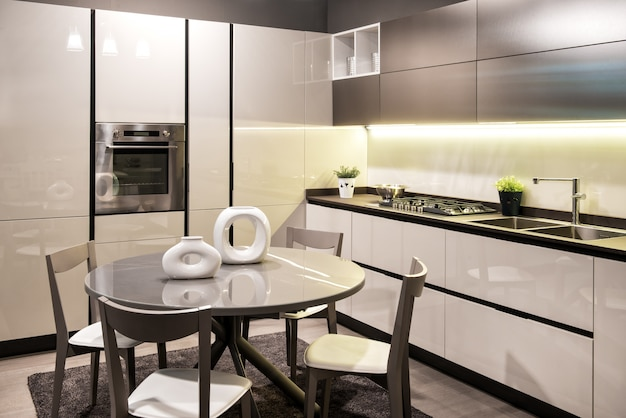 Modern built in kitchen with circular dining table