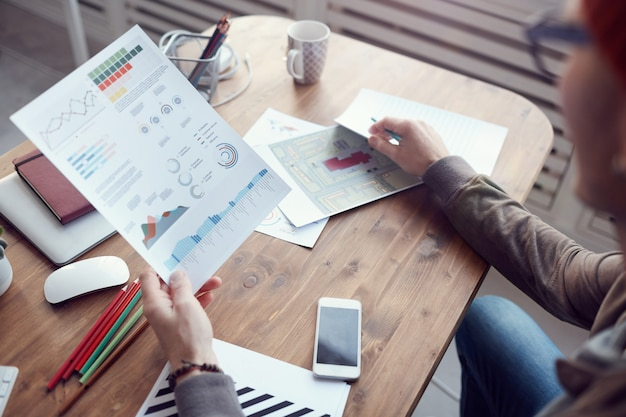 Modern business analyst holding data chart