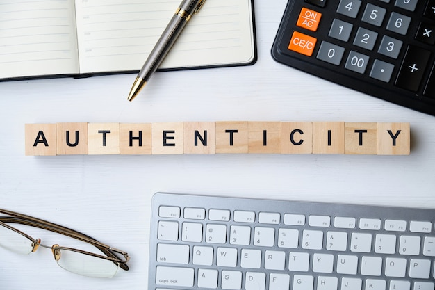 Modern business buzzword - authenticity. top view on wooden table with blocks. top view.