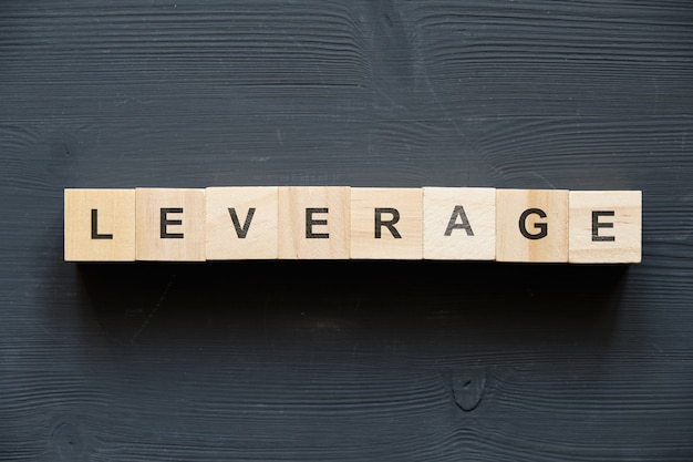 Modern business buzzword - leverage. top view on wooden table with blocks. top view.