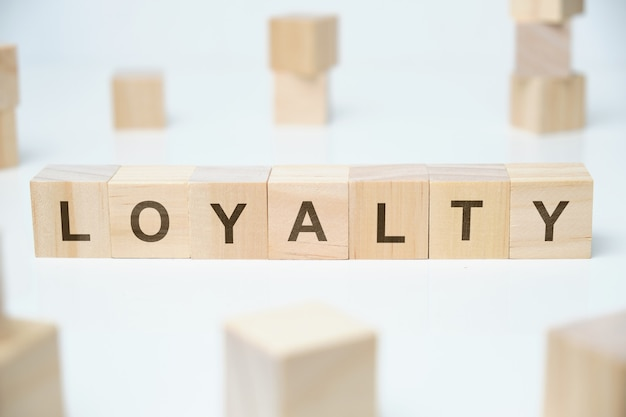 Modern business buzzword - loyalty. word on wooden blocks on a white space.