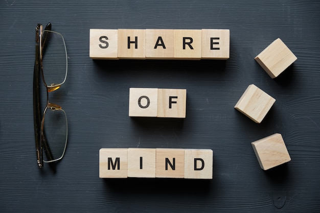 Modern business buzzword - share of mind. top view on wooden table with blocks. top view.