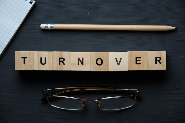 Modern business buzzword - turnover. top view on wooden table with blocks. top view.