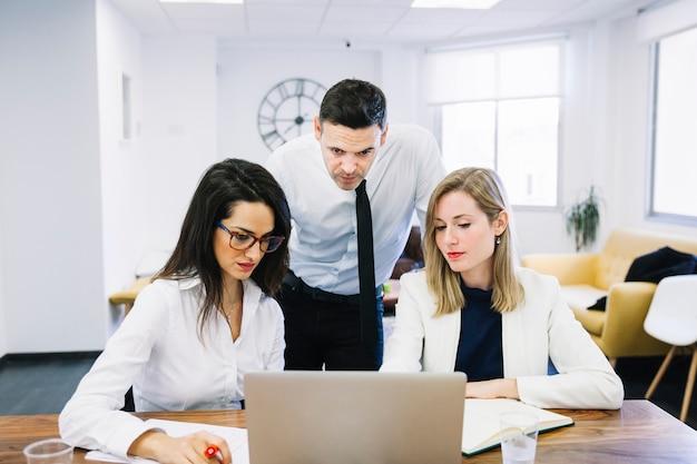 Modern business people at desk