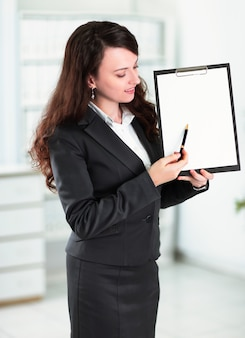 Modern business woman pointing at blank sheet
