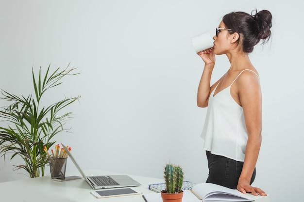 Modern businesswoman drinking coffee