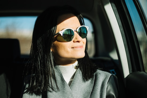 Modern businesswoman sitting in car